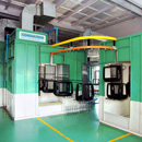 Conveyorised paint booth